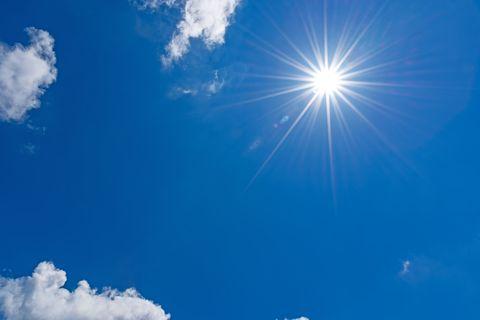 sun on blue sky with clouds