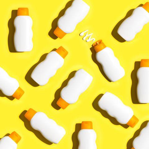 sunblock bottles a yellow background