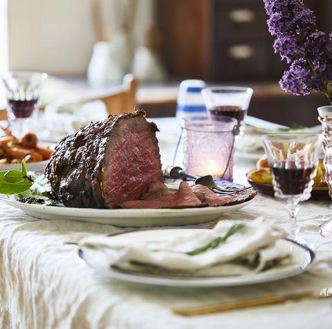 Sunday roast on dining table, ready to serve