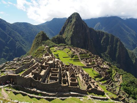 Sunny view of  Machu Picchu, a 15th-century Inca citadel...