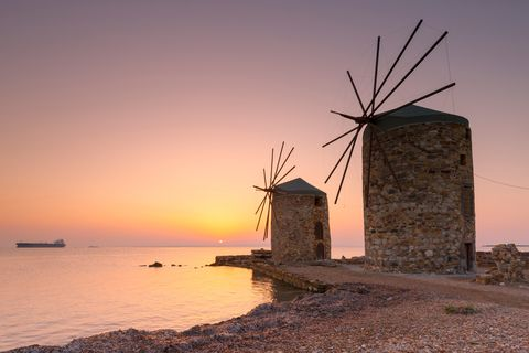 sunrise image of the iconic windmills in chios town