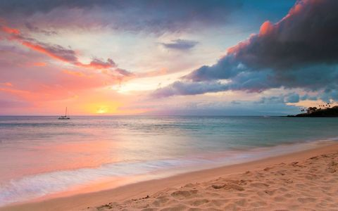 Sunset at beach with boat in distance, Kaanapali, Maui, Hawaii, USA