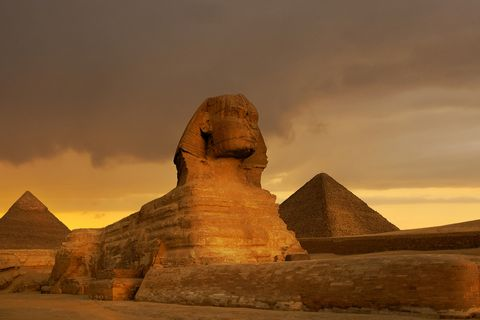 sunset at the sphinx and pyramid complex giza, egypt