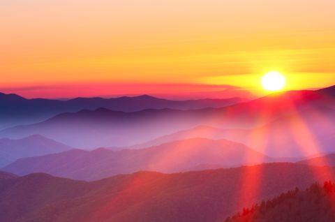 Sunset on a foggy mountain range