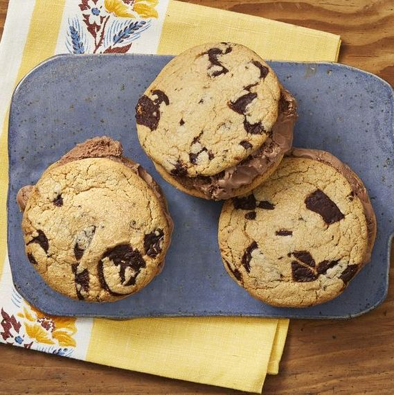 chocolate chip cookie ice cream sandwiches on a blue board