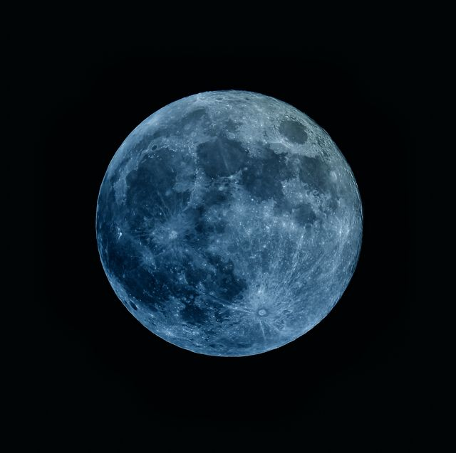 a moon that is tinted blue