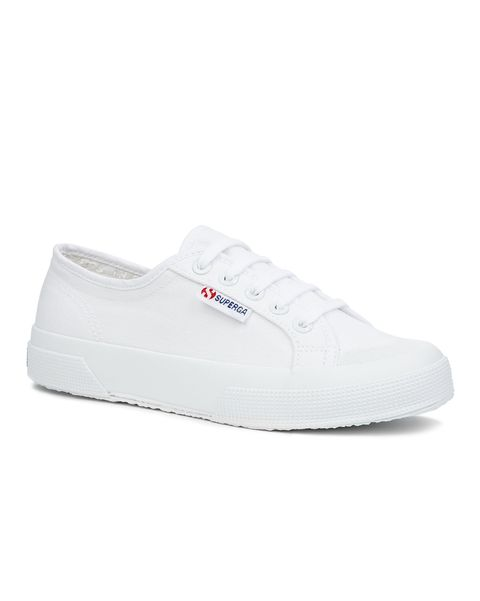 still life shot of white trainers
