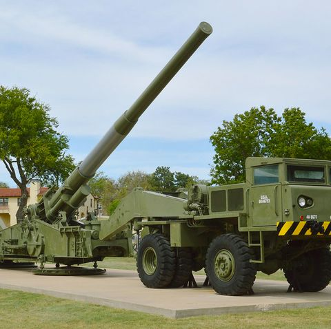 Mode of transport, Vehicle, Military vehicle, Self-propelled artillery, Transport, Military, Missile, Cannon, Combat vehicle, Grass,
