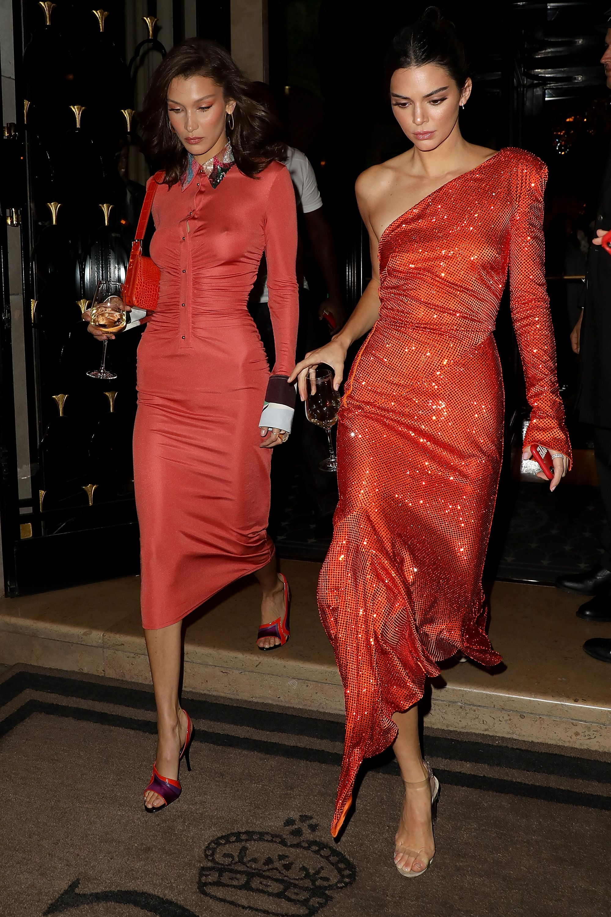September 26, 2018 Kendall and Bella attended the YouTube cocktail party in Paris hand in hand while wearing dresses in similar red hues. Bella opted for long sleeves and a mini length while Kendall chose a one-shoulder sparkly number.
