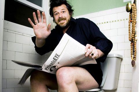 Surprised man caught in the bathroom.