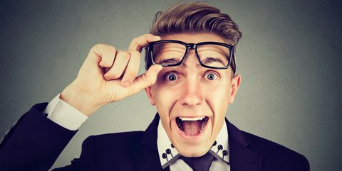 Surprised young business man with glasses