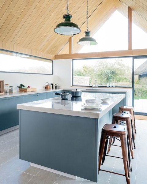 Blue kitchen with a breakfast bar and wooden roof