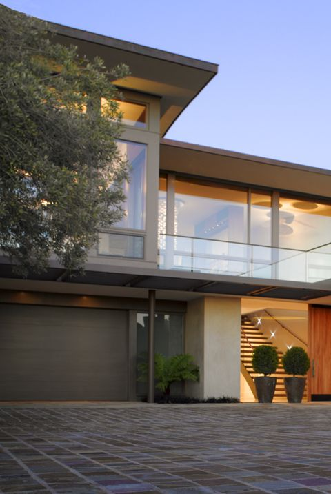 30 Stunning Modern Houses - Photos of Modern Exteriors on home furnishings, home lighting, industrial home design, bathroom design, country home design, furniture design, product design, hotel design, house design, modern house, lighting design, modern interior, mid century home design, apartment design, luxury home design, traditional home design, restaurant design, home decor, graphic design, dining room design, modern kitchen, american home design, architecture design, interior design, nice home design, modern concrete homes, landscape design, modern mansions, office design, living room design, rustic home design, kitchen design, bedroom design, modern schools,