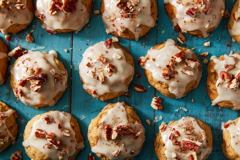 iced cookies sprinkled with chopped nuts