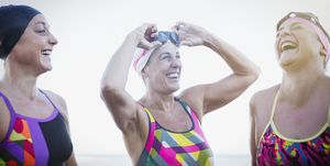 Laughing female open water swimmers