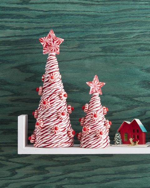 cone shaped christmas trees covered in candy cane sticks