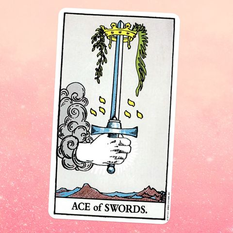 the tarot card the ace of swords, showing a hand coming out of the sky holding a giant sword