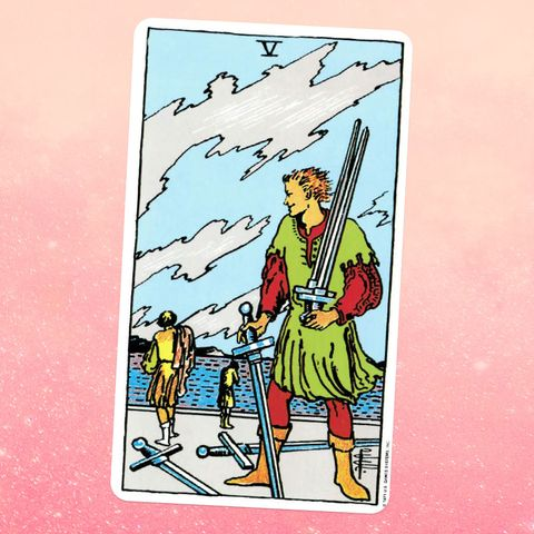 the tarot card the five of swords, showing a person carrying three swords with two more on the ground two more people can be seen in the distance in the background