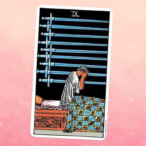 the tarot card the nine of swords   a man sits up in bed with his face in his hands, and nine swords hang on the wall next to him