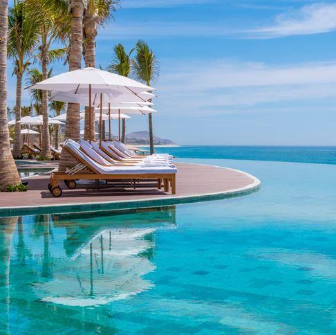 Swimming pool, Resort, Property, Azure, Aqua, Leisure, Vacation, Caribbean, Sunlounger, Sea,