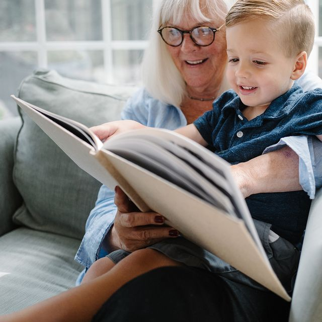 grandmother and grandson looking at photo album