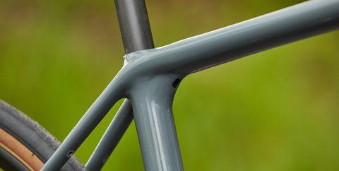 Green, Bicycle part, Bicycle wheel, Metal, Bicycle frame, Bicycle, Spoke, Bicycle tire, Steel, Close-up,
