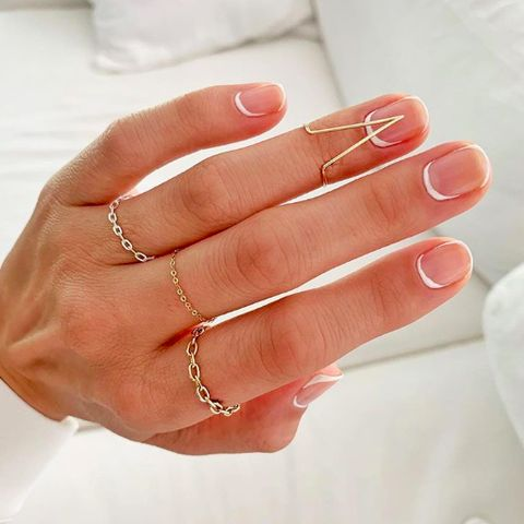 Nail, Finger, Ring, Hand, Manicure, Nail care, Skin, Body jewelry, Wedding ring, Fashion accessory,
