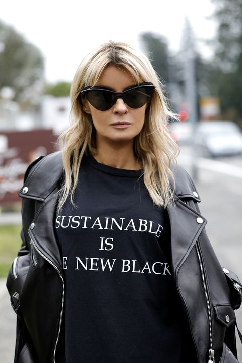 """dusseldorf, germany   march 20 influencer gitta banko, wearing a fringed oversized leather jacket by jacob lee, a black t shirt with """"sustainable is the new black"""" print by redemption and sunglasses by mykita x maison margiela during a street style shooting on march 20, 2020 in dusseldorf, germany photo by isa foltingetty images"""