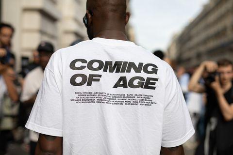 White, T-shirt, Fashion, Street fashion, Human, Shoulder, Font, Crowd, Top, Event,