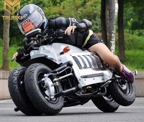 Land vehicle, Vehicle, Motorcycle, Motorcycle helmet, Motor vehicle, Car, Motorcycling, Helmet, Road racing, Automotive design,