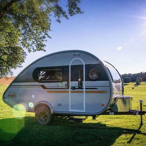 Vehicle, Travel trailer, Motor vehicle, Grass, Transport, Trailer, RV, Car, Tree, Sky,