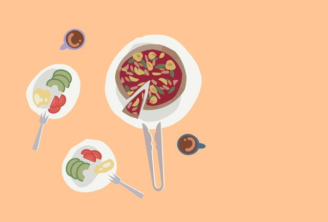 table setting with pizza, coffee cup, avocado, tomato and egg