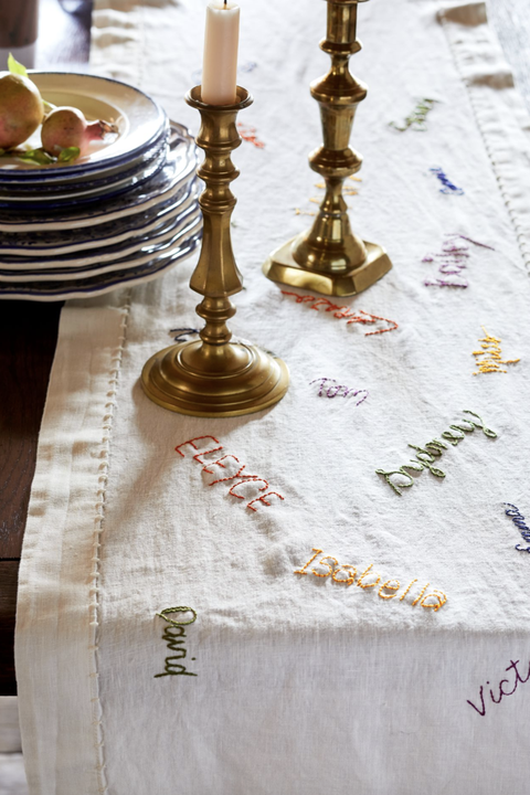 a tablecloth featuring family members' first names embroidered into it