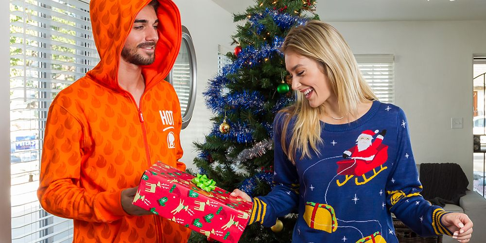 Taco Bell Hours Christmas.Taco Bell S Holiday Collection Includes Ugly Christmas Sweaters And Hot Sauce Packet Onesies