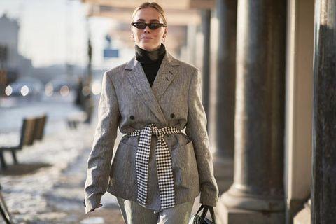 Clothing, Street fashion, Fashion, Outerwear, Eyewear, Fashion model, Suit, Coat, Neck, Sunglasses,
