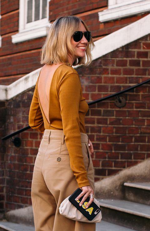 Clothing, Street fashion, Yellow, Waist, Orange, Shoulder, Eyewear, Sunglasses, Fashion, Brown,