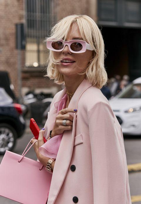 Eyewear, Pink, Hair, Sunglasses, Street fashion, Clothing, Blond, Trench coat, Glasses, Fashion,