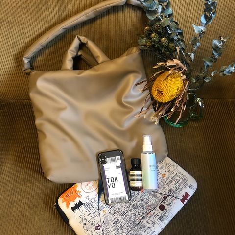 Brown, Bag, Shoulder bag, Luggage and bags, Beige, Mobile phone, Bottle, Portable communications device, Material property, Strap,