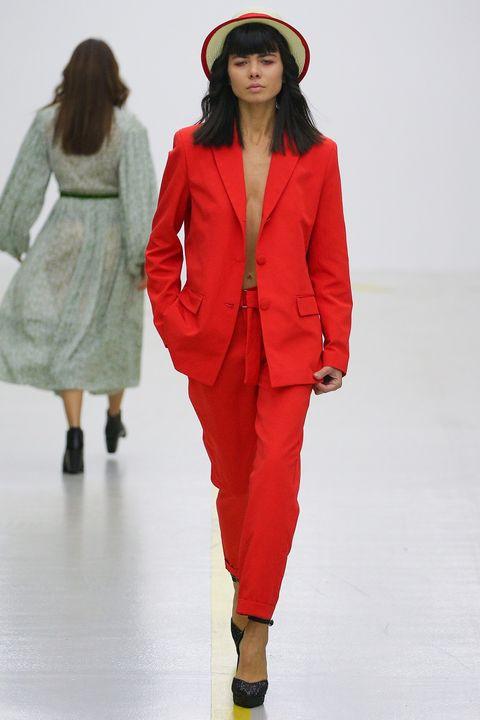 Fashion show, Fashion model, Runway, Fashion, Clothing, Red, Outerwear, Human, Pantsuit, Coat,
