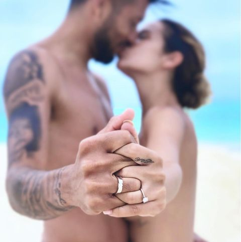Skin, Love, Romance, Hand, Ring, Engagement ring, Interaction, Arm, Gesture, Muscle,