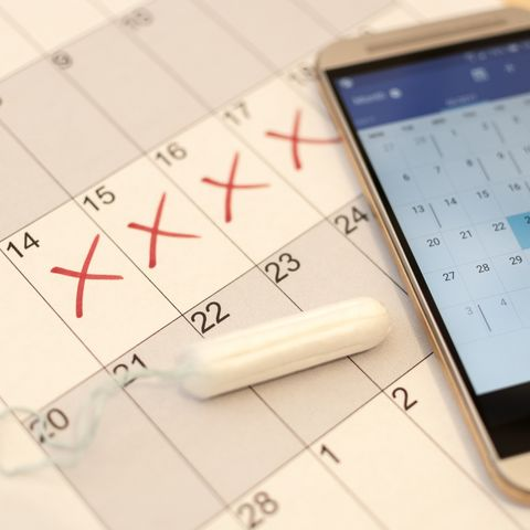 Tampon, Paper and Smartphone Calendar - menstruation cycle