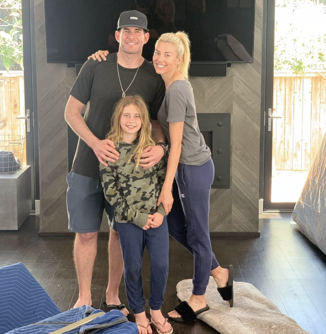 heather rae young, tarek el moussa, and taylor reese standing  in living room
