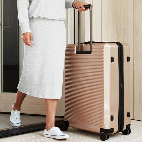 Product, Suitcase, Standing, Hand luggage, Leg, Beige, Luggage and bags, Knee,