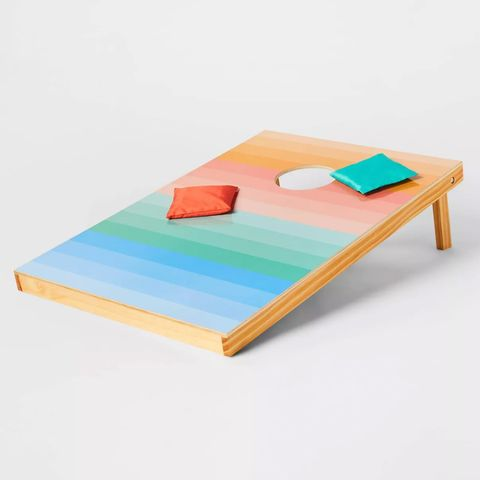 a wooden ombré stripes cornhole set with bean bags from target's sun squad collection
