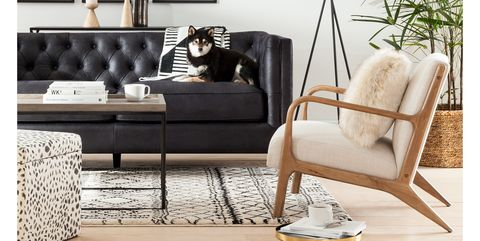 Furniture, Black, Room, Living room, Interior design, Table, Coffee table, Couch, Material property, Black-and-white,