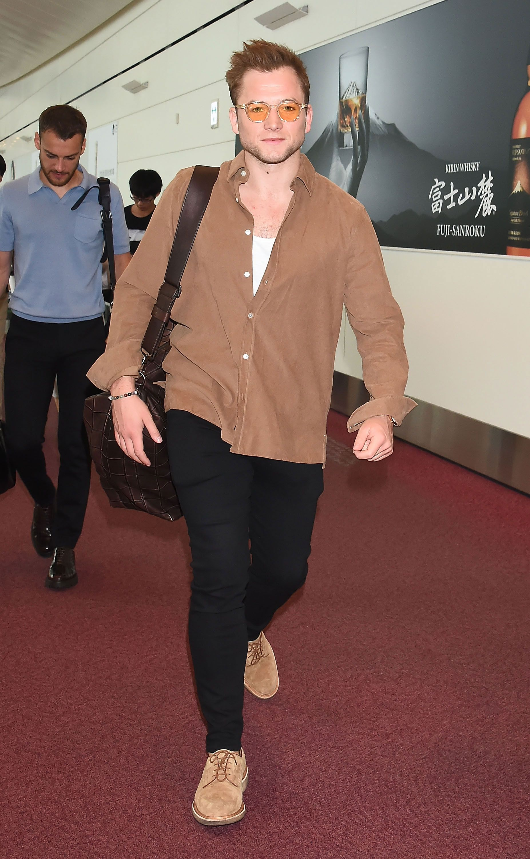 Taron Egerton's Toasty Tan Shirt Is a Perfect Airport Style Flex