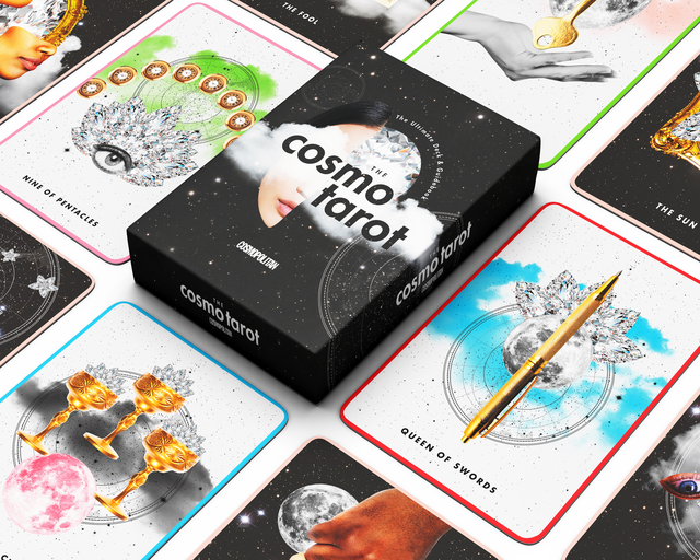 the cosmo tarot deck lies on a white background surrounded by tarot cards