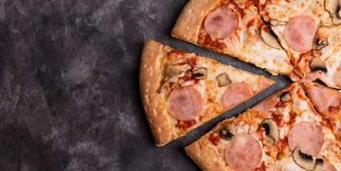 tasty sliced pizza on black concrete background top view of hot pizza
