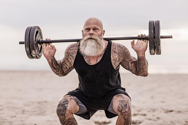 tattooed senior man during workout