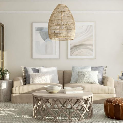 Living room, Furniture, Room, Interior design, Couch, Coffee table, Table, Wicker, studio couch, Floor,